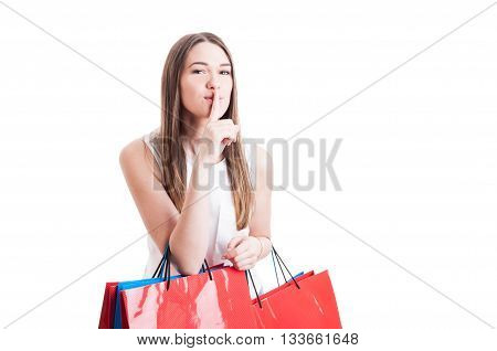 Attractive Pretty Shopaholic With Shopping Bags Making A Silence Gesture