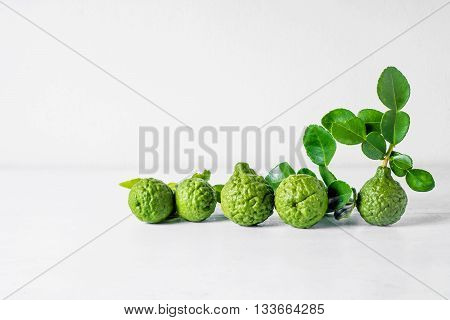 Bergamot fruit on white wooden table background .