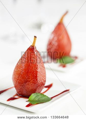 A dessert of sweet pears cooked in red wine