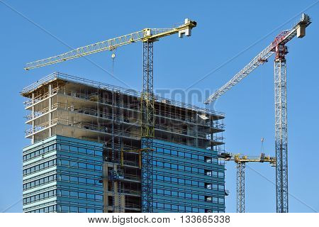 VILNIUS LITHUANIA - OCTOBER 06: Construction progressing of office building in Vilnius on October 06 2015 in Vilnius Lithuania. Vilnius is the capital of Lithuania and its largest city.