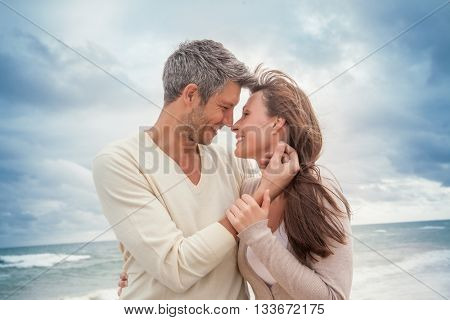 teasing couple outdoors in coastline
