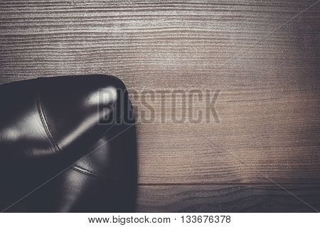 shy man standing on wooden floor background