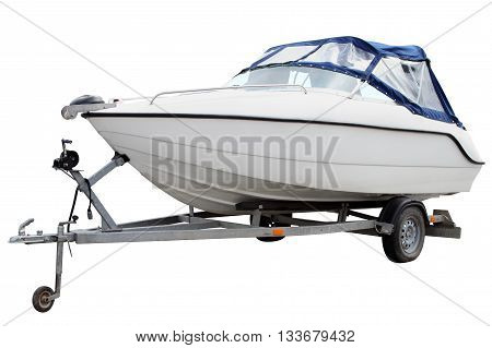 White motor boat loaded on the trailer for transportation.