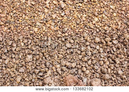 Many small stones the background reddish brown.