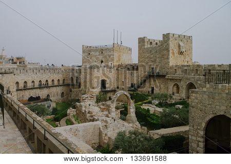 Towers And Walls Of Jerusalem Citadel And Tower Of David  In Sandstorm. Jerusalem, Israel