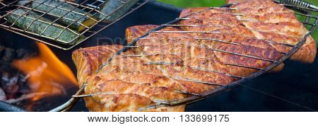 Grilled fish with spices on fire.Salmon fillet on the grill and flame.