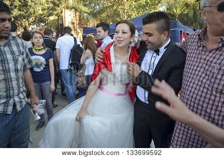 Istanbul Turkey - June 9 2013: Newly married couple in the protest area the bride and groom. A wave of demonstrations and civil unrest in Turkey began on 28 May 2013 initially to contest the urban development plan for Istanbul's Taksim Gezi Park.