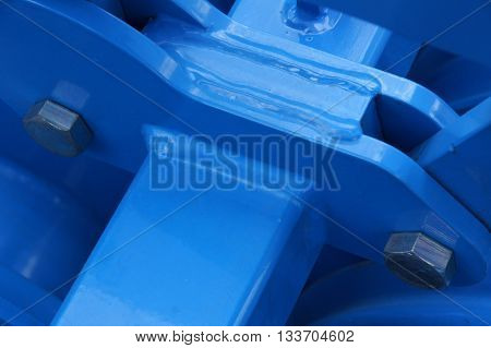 Connection of the painted metallic parts into a single structure with bolts and welding