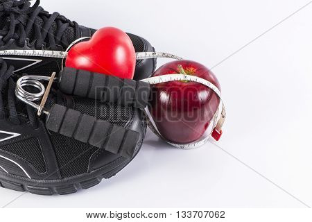 Fitness background with heart, handgrip and apple