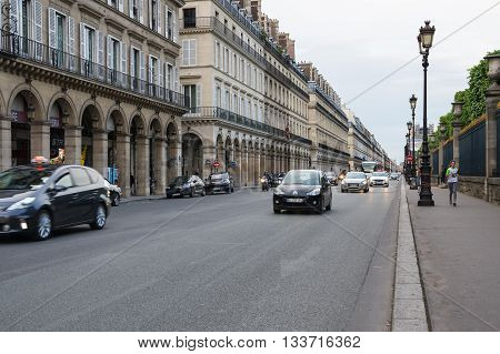 PARIS FRANCE - MAY 07 2015: Traffic on Rue de Rivoli in the historical center of Paris in the dusk France