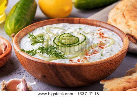 Greek salad tzatziki of cucumber yogurt olive oil garlic dill and spices selective focus.