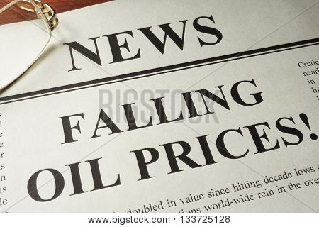 Newspaper with header news and Falling oil prices.  Oil price drop concept.