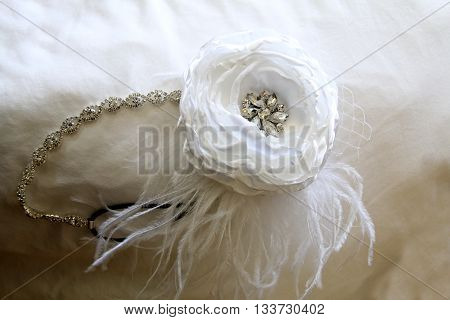 Hair jewellery resting atop of white fabric