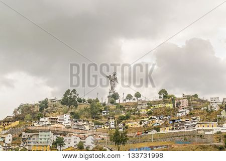 Colonial Buildings And The Panecillo In Quito Ecuador
