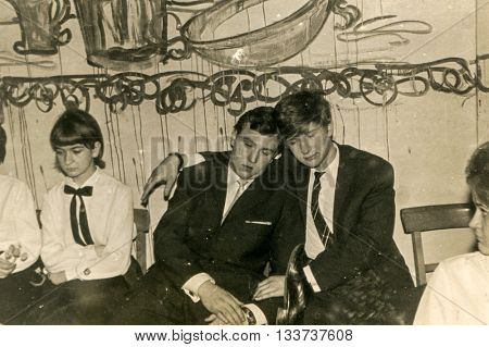 LODZ, POLAND, CIRCA 1967: Vintage photo of drunk schoolboys during a prom