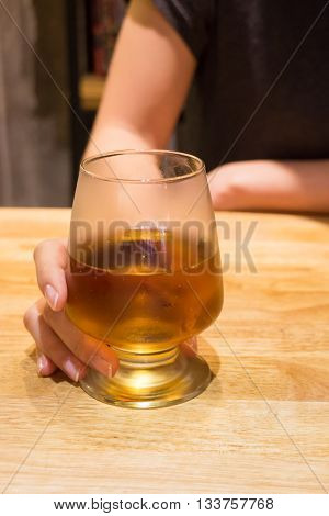 Woman having alcoholic drink in the bar stock photo