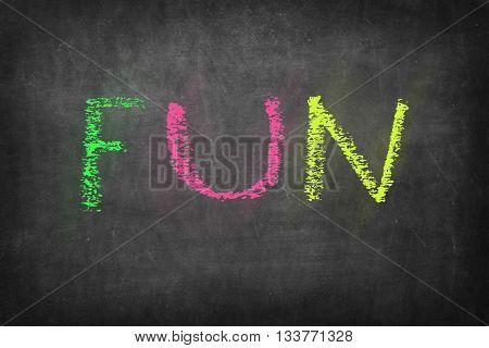 FUN colorful word on black blackboard background