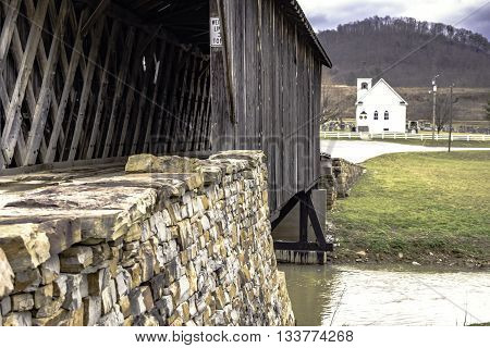 Goddard, Kentucky, February 26, 2016: Goddard White Bridge the only surviving example of Ithiel Town Lattice design in Kentucky. The timbers are joined with wooden pegs.