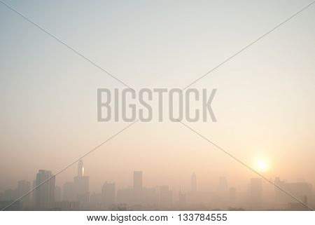 smog cityscape at sunset and blue sky