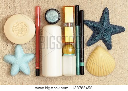 Cosmetics on the white sands of the sea