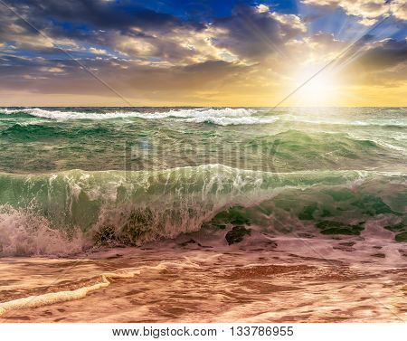 Huge Sea ​​waves Running On Sandy Beach At Sunset
