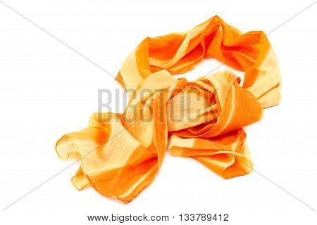 Orange scarf with tassels isolated on white background.