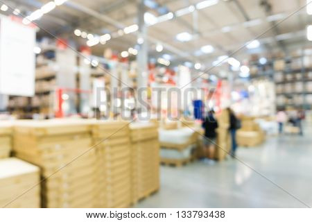 Blurred Large Furniture Warehouse Store Industry