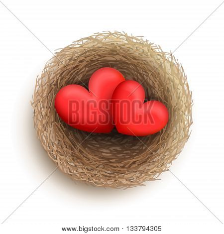 Two red hearts are laying together in nest. Family and fireside concept. Love and harmony in family life