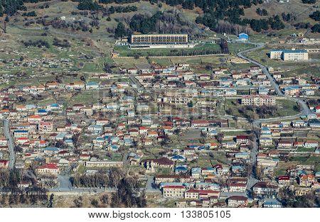 Stepantsminda Georgia - April 25 2015. Aerial view on Stepantsminda town also known as Kazbegi in Georgia
