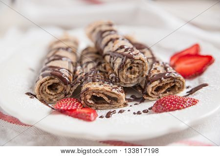 traditional crepes with fresh strawberries and chocolate