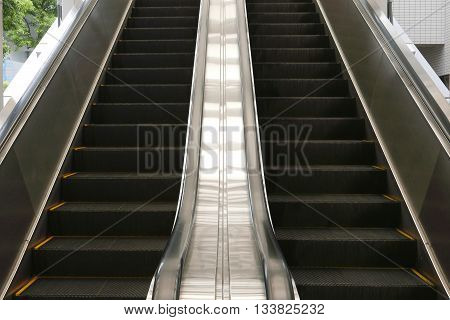 moving lift escalator perspective angle in the airport