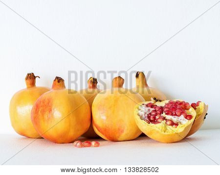 ripe Pomegranate on white background fruits rich of vitamin especially tannin which help in free radical therapy