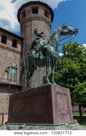 TURIN ITALY - APRIL 24 2016: Equestrian monument portraying a military Carabinieri Cavalry with the reins in one hand and a banner sculpted by Pietro Canonica in 1923