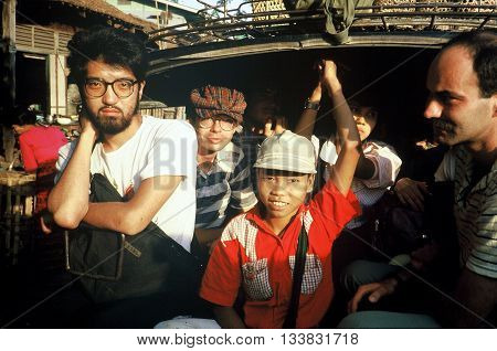 PAGAN / BURMA (NOW CALLED MYANMAR) - CIRCA 1987: Travelers ride a transport from the train station into the city of Pagan.