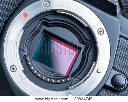 cmos sensor or also called digital ccd installed on mirorless camera showing red polarized filter on the top