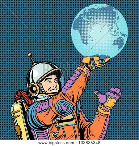 Retro astronaut is holding the planet Earth on hand pop art retro vector. Caring for the planet. Earth day and the day of environmental protection