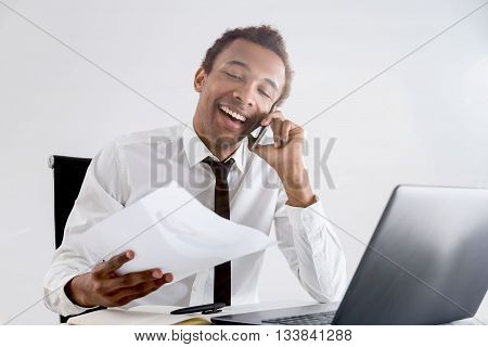 Smiling Black Businessman On Phone