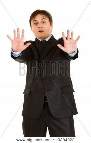 Portrait of scared young businessman isolated on white