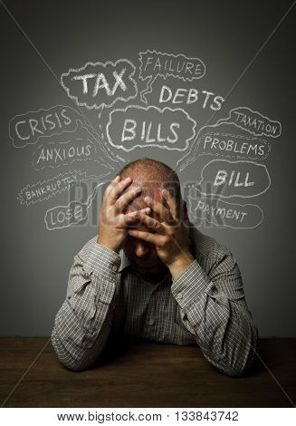 Frustrated man. Taxes debts and other problems.