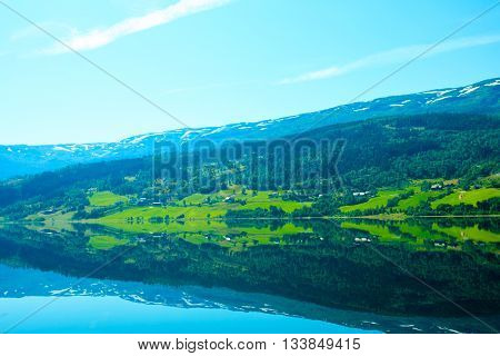 Tourism vacation and travel. Landscape and fjord in Norway Scandinavia. mountain reflections in water. poster