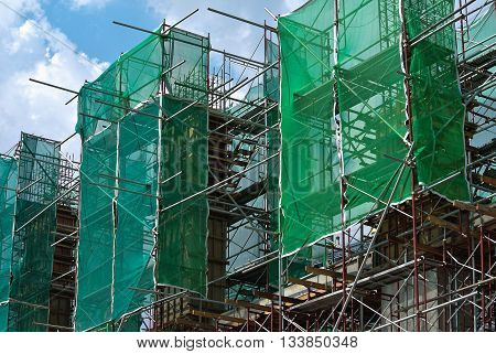 SELANGOR, MALAYSIA -JANUARY 13, 2015: Scaffolding as the temporary structure used to support platform or form work at the construction site. Construction workers also used it as walking platform.