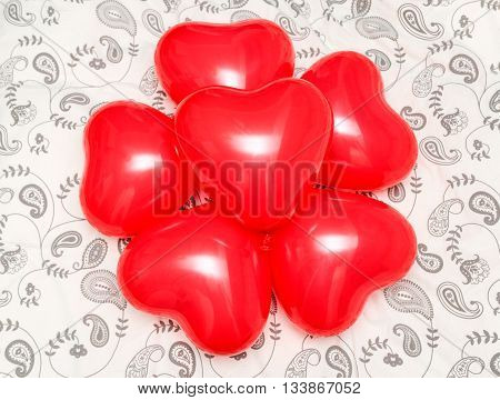 Composition of red heart shaped balloons on a blanket. Concept for romanticism