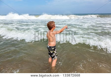boy has fun in the stormy beach