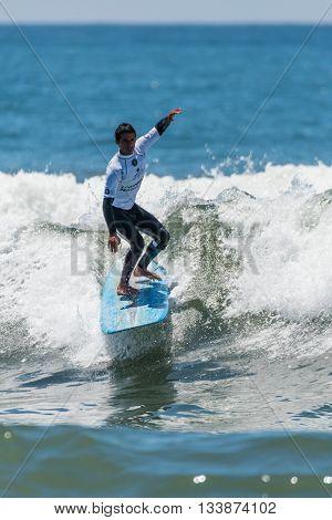 GAIA PORTUGAL - JUNE 11, 2016: Augusto Olinto (BRA) at LQS Longboard Pro Gaia Men's Longboard Tour #3.