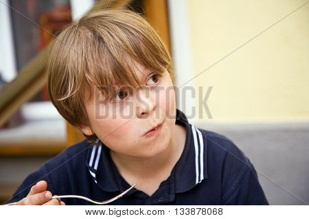 Eating Boy Is Looking Astonished And Interested