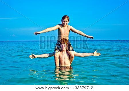 Brothers   Enjoy The Clear Warm Water And Play Pickaback