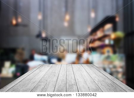 Black and white wooden with blurred background in coffee shop, stock photo