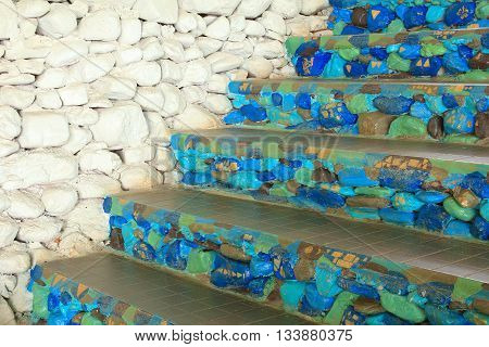 Stone staircase pattern, light blue, dark blue with white stone wall.