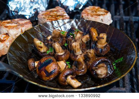 Roasted Mushrooms In Pan On Barbecue