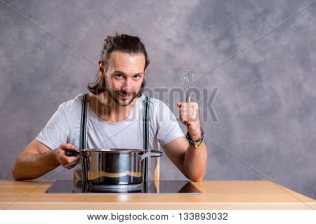 Young Bearded Man With Cooking Pot And Egg Whish